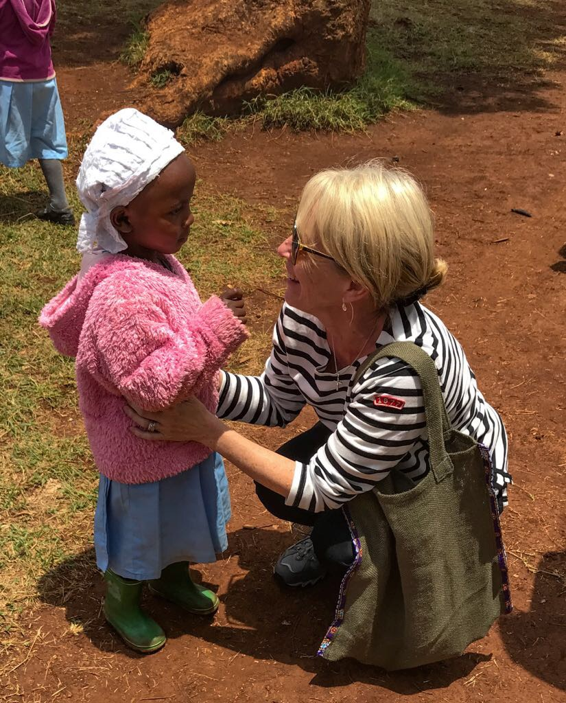 Andrea Powis meeting a young girl in her travels
